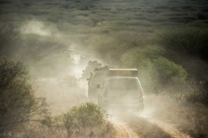 An official leads the team of nine vehicles through the conservancy to the furthest checkpoint where we will set up camp.